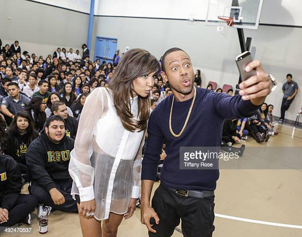 Actress Naya Rivera and host Terrence Jenkins take a selfie at Get Schooled to recognize student success at Collins Family High School on May 20 2014...