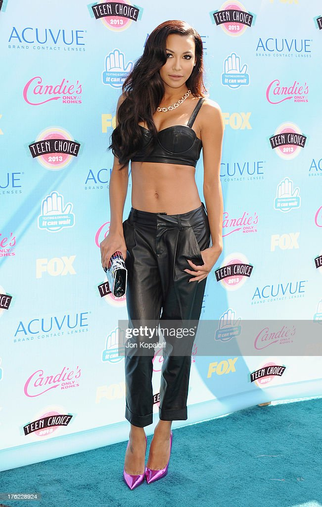 Actress <a gi-track='captionPersonalityLinkClicked' href=/galleries/search?phrase=Naya+Rivera&family=editorial&specificpeople=5745696 ng-click='$event.stopPropagation()'>Naya Rivera</a> arrives at the 2013 Teen Choice Awards at Gibson Amphitheatre on August 11, 2013 in Universal City, California.