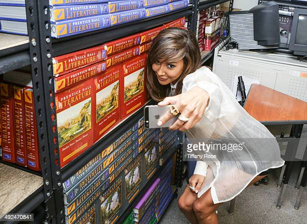 Actress Naya Rivera takes a selfie at Get Schooled to recognize student success at Collins Family High School on May 20 2014 in Los Angeles California