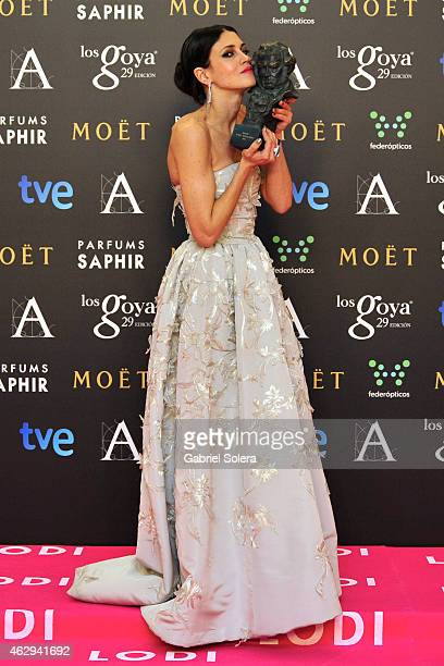 Actress Nerea Barros holds the award for Best new actreess award in the film 'La Isla minima' during the 2015 edition of the Goya Cinema Awards at...