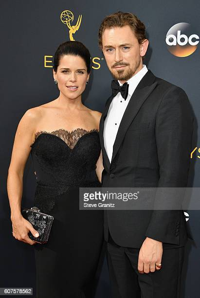 Actress Neve Campbell and actor JJ Field attend the 68th Annual Primetime Emmy Awards at Microsoft Theater on September 18 2016 in Los Angeles...