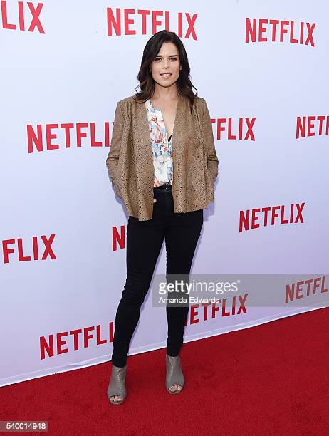 Actress Neve Campbell arrives at the Netflix Emmy Season Casting Event at the Paramount Theatre on June 13 2016 in Hollywood California