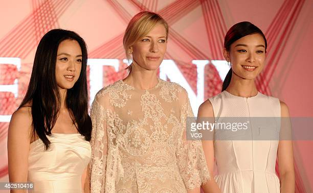 Actress Ni Ni actress Cate Blanchett and actress Tang Wei attend a commercial activity on July 22 2014 in Shanghai China