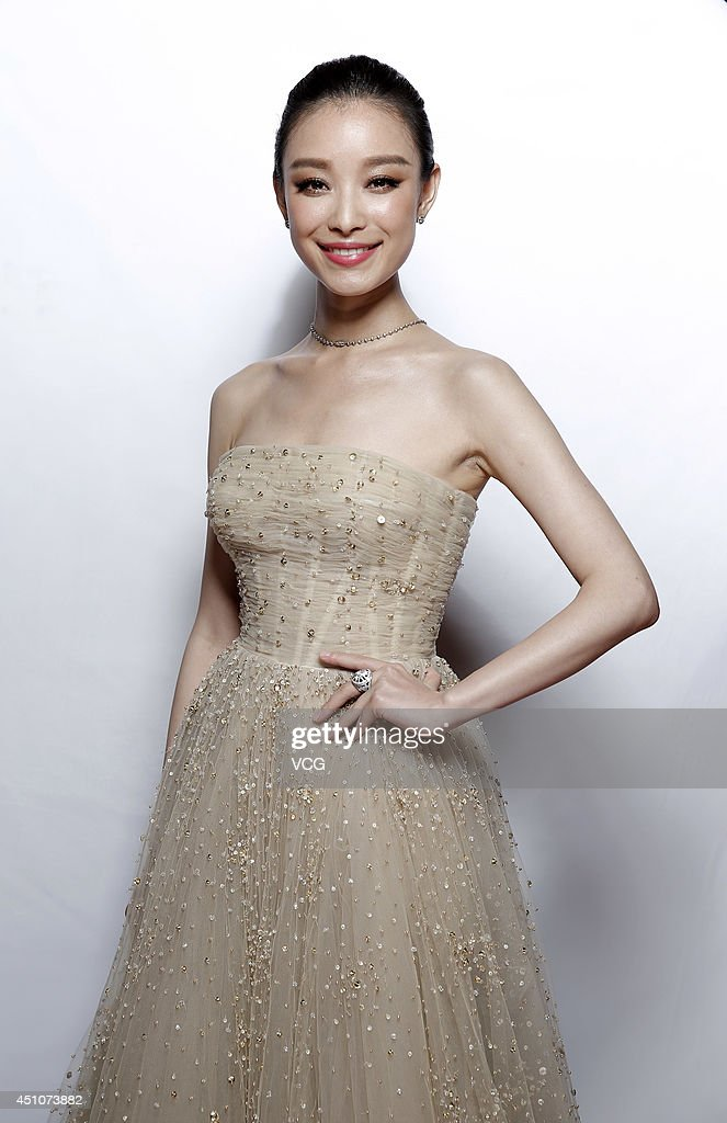 Actress <a gi-track='captionPersonalityLinkClicked' href=/galleries/search?phrase=Ni+Ni&family=editorial&specificpeople=8736550 ng-click='$event.stopPropagation()'>Ni Ni</a> attends closing and award ceremony of 17th Shanghai International Film Festival at Shanghai Grand Theatre on June 22, 2014 in Shanghai, China.