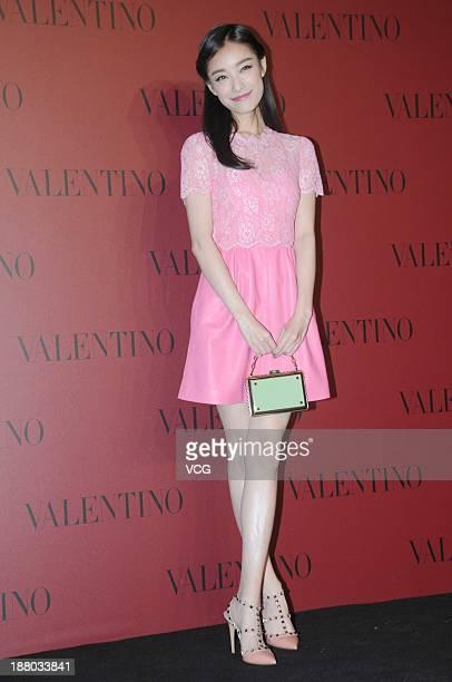 Actress Ni Ni attends Valentino Fashion Show at Shanghai Port International Cruise Terminal on November 14 2013 in Shanghai China