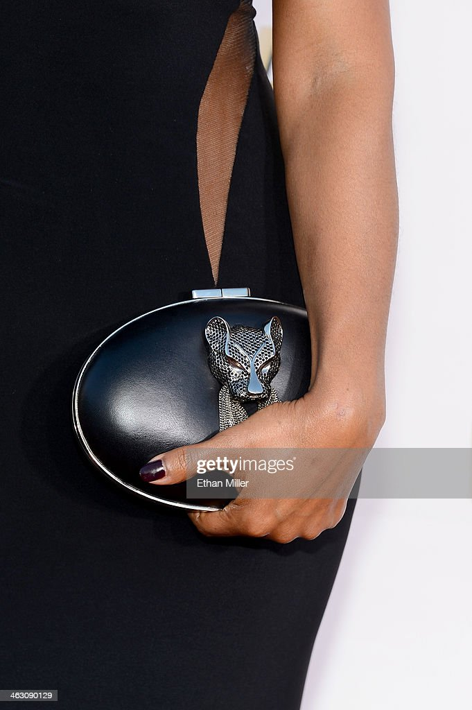 Actress Nia Long (handbag detail) attends the 19th Annual Critics' Choice Movie Awards at Barker Hangar on January 16, 2014 in Santa Monica, California.