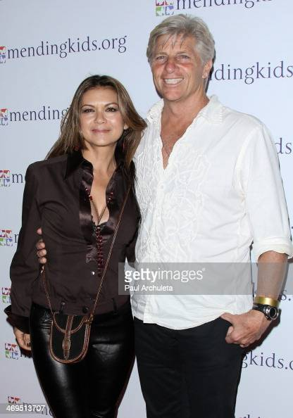 Actress Nia Peeples and her Husband ProSurfer Sam George attend the Mending Kids International's 'Rock Roll AllStars' fundraising event on February...