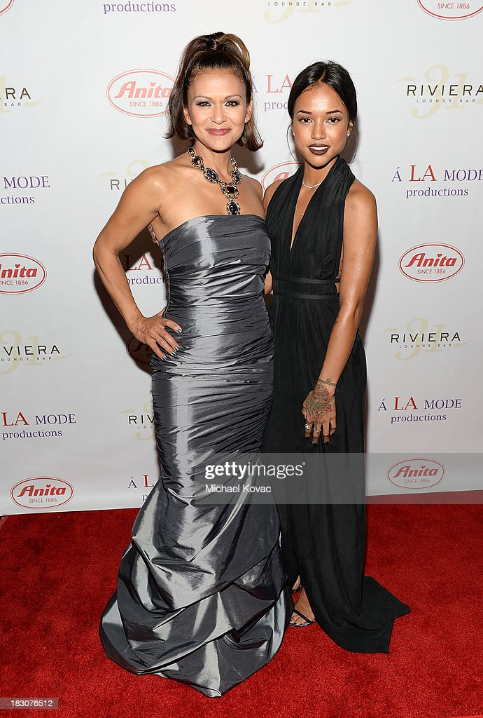Actress Nia Peeples and model Karrueche Tran arrive for A la mode Productions Presents Designers Night Out at Sofitel Hotel on October 3, 2013 in Los Angeles, California.