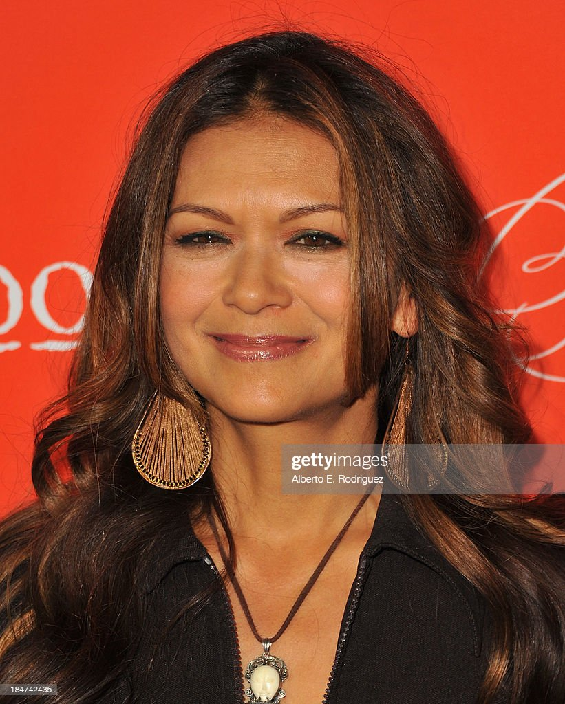 Actress <a gi-track='captionPersonalityLinkClicked' href=/galleries/search?phrase=Nia+Peeples&family=editorial&specificpeople=635440 ng-click='$event.stopPropagation()'>Nia Peeples</a> attends a screening of ABC Family's 'Pretty Little Liars' Halloween episode at Hollywood Forever Cemetery on October 15, 2013 in Hollywood, California.