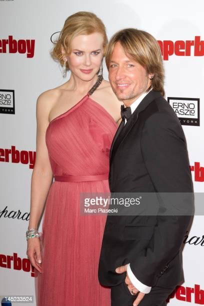 Actress Nicole Kidman and husband Keith Urban attend the 'Paperboy' photocall at Carlton beach during the Cannes Film Festival on May 24 2012 in...
