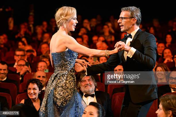 Actress Nicole Kidman dances with French actor and Master of Ceremony Lambert Wilson at the Opening ceremony during the 67th Annual Cannes Film...