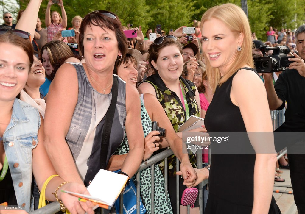 Actress <a gi-track='captionPersonalityLinkClicked' href=/galleries/search?phrase=Nicole+Kidman&family=editorial&specificpeople=156404 ng-click='$event.stopPropagation()'>Nicole Kidman</a> poses for a photo with fans at the 2013 CMT Music Awards at the Bridgestone Arena on June 5, 2013 in Nashville, Tennessee.