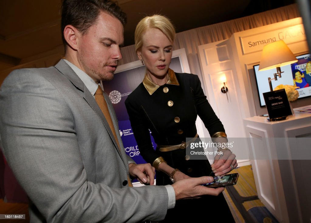 Actress Nicole Kidman signs photo for Samsung's Signatures for Good on the Samsung Galaxy Note 3 at Variety's 5th Annual Power of Women event presented by Lifetime at the Beverly Wilshire Four Seasons Hotel on October 4, 2013 in Beverly Hills, California.