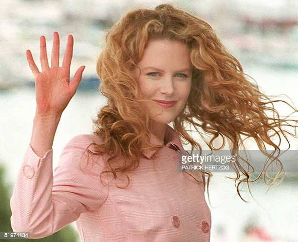 Actress Nicole Kidman waves to photographers 20 May at the Cannes' Palais des Festivals during the presentation to the press of her film ' To die...
