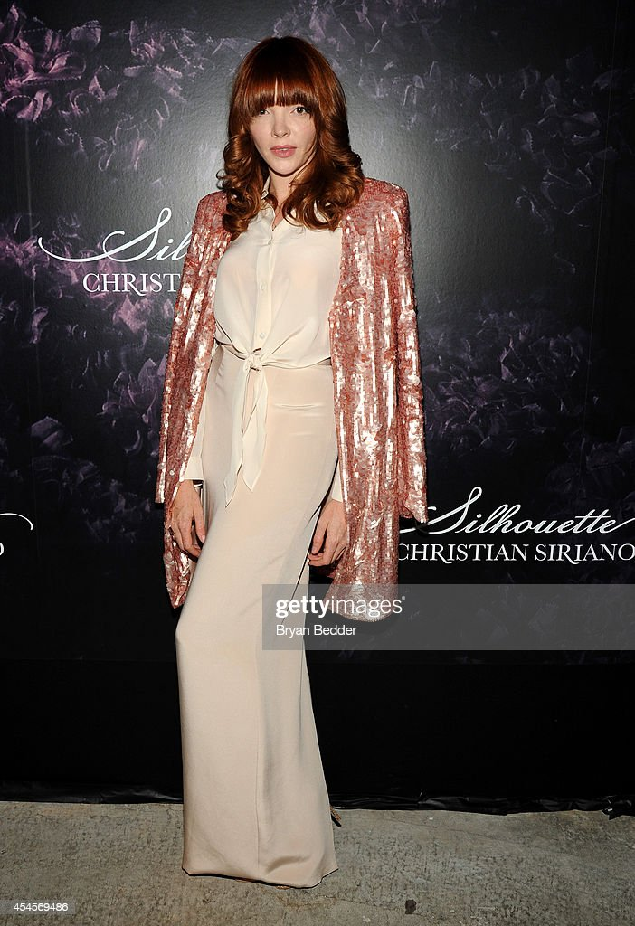 Actress Nicole LaLiberte attends Christian Siriano's celebration of his new fragrance with a Stoli Vodka cocktail at the designer's popup Silhouette...