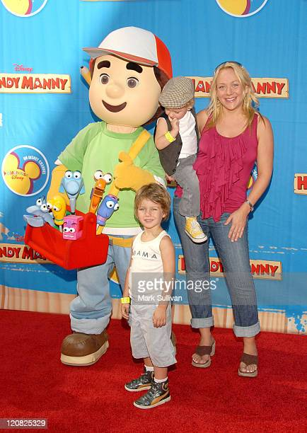 Actress Nicole Sullivan poses with Handy Manny and chidren at the exclusive premiere of the upcoming primetime special 'Handy Manny Motorcycle...