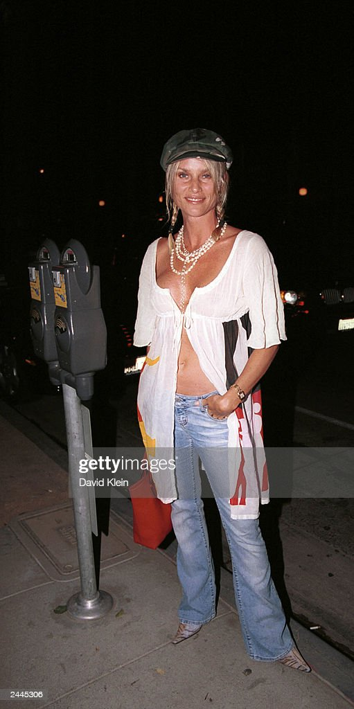 Actress Nicolette Sheridan poses at the Latin Lounge August 28, 2003 in West Hollywood, California.