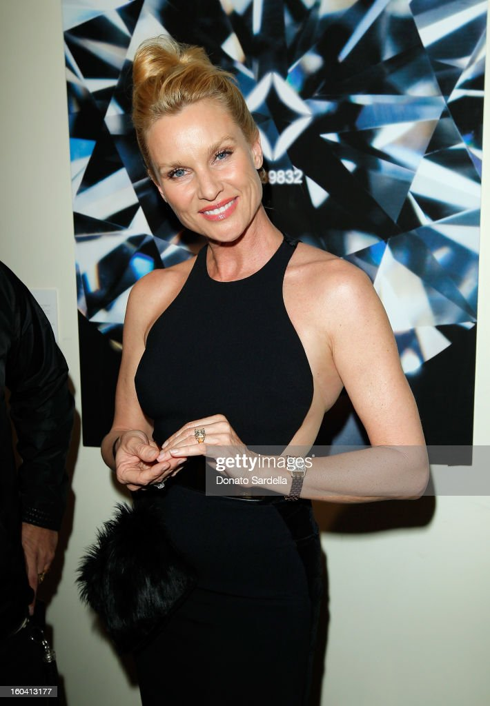 Actress Nicollette Sheridan attends Hoorsenbuhs for Forevermark Collection cocktail party at Chateau Marmont on January 30, 2013 in Los Angeles, California.