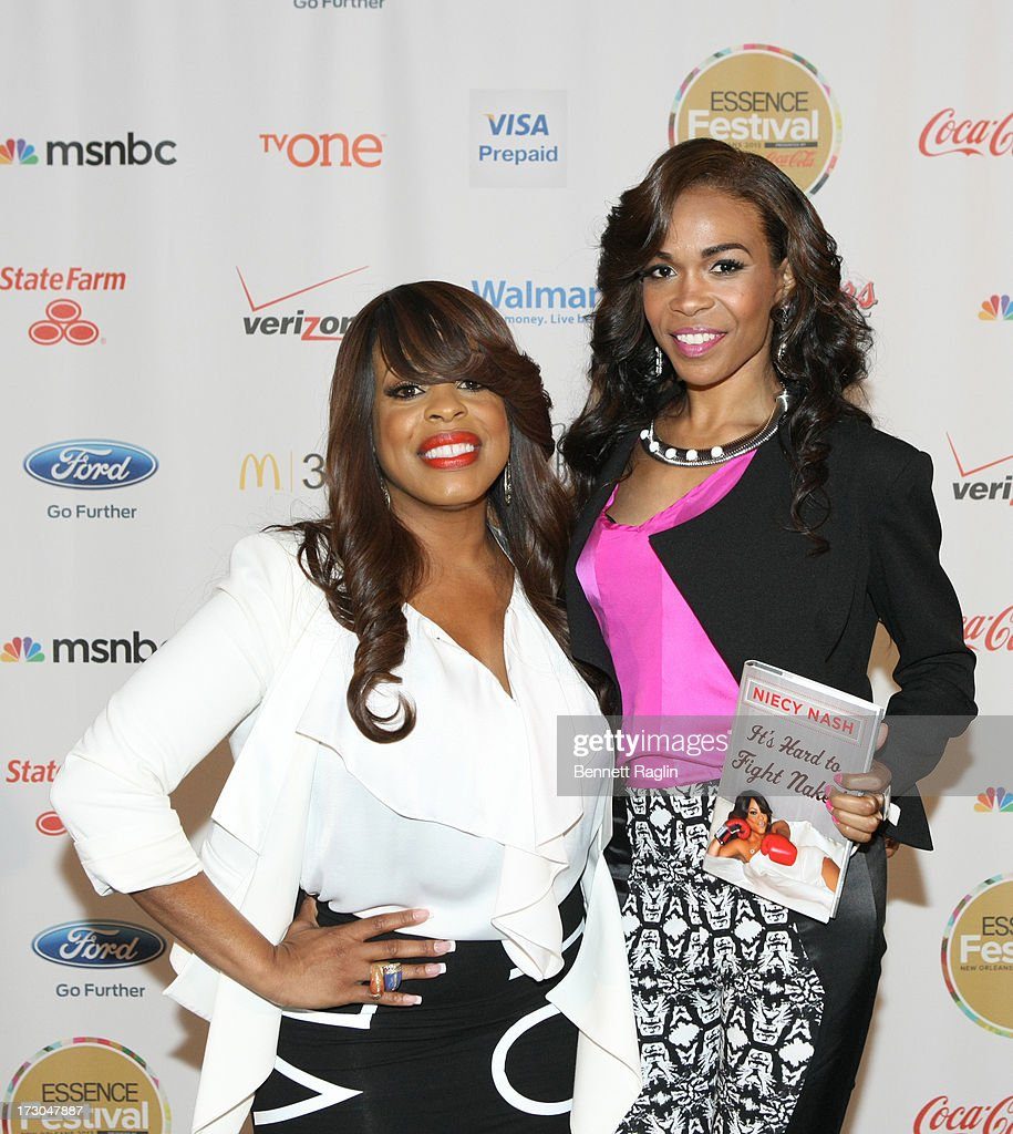 Actress <a gi-track='captionPersonalityLinkClicked' href=/galleries/search?phrase=Niecy+Nash&family=editorial&specificpeople=228464 ng-click='$event.stopPropagation()'>Niecy Nash</a> and recording artist Michelle Williams attend the 2013 Essence Festival at the Ernest N. Morial Convention Center on July 5, 2013 in New Orleans, Louisiana.