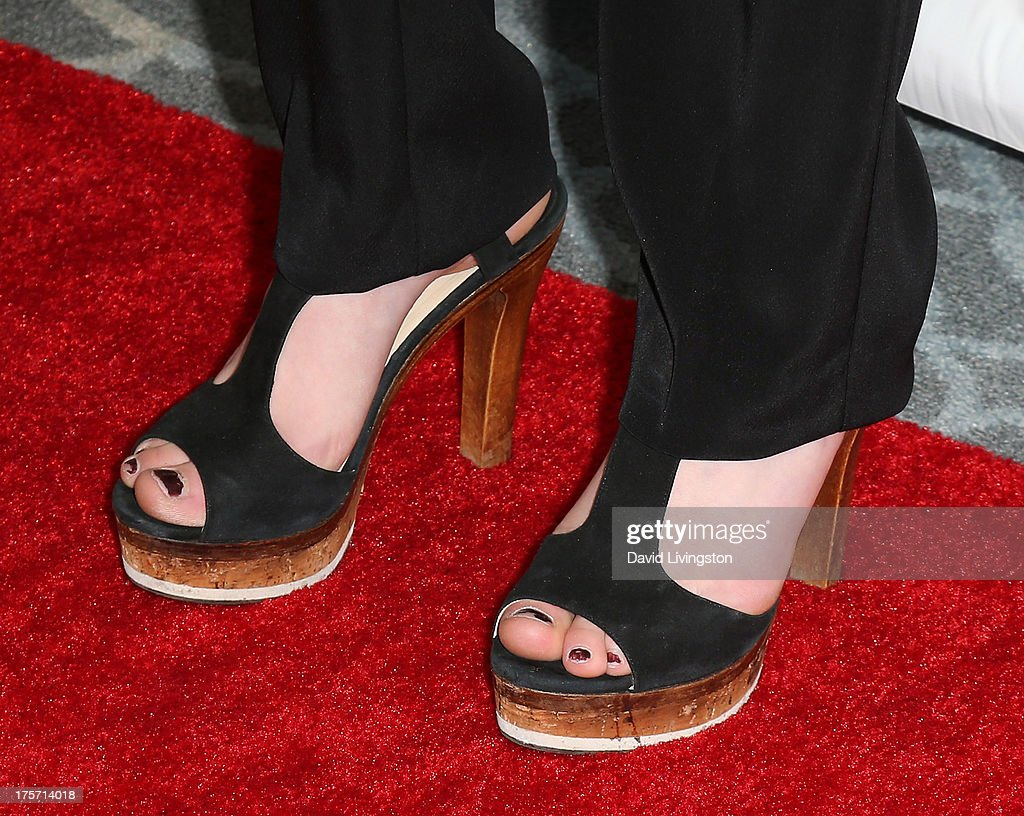 Actress Niki Koss (shoe detail) attends a screening of Integrity Film Production's 'Red Wing' at Harmony Gold Theatre on August 6, 2013 in Los Angeles, California.