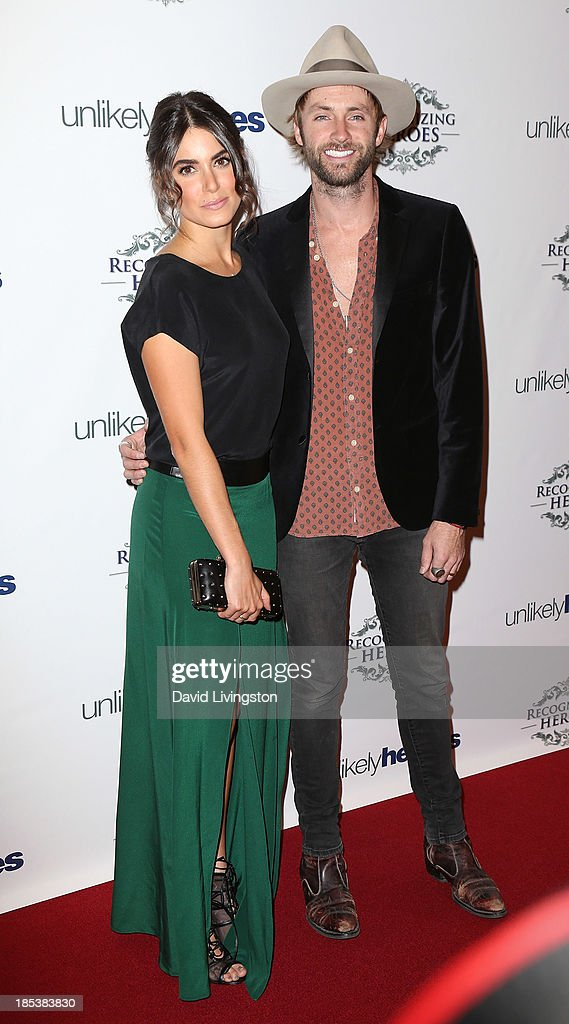 Actress Nikki Reed (L) and husband singer Paul McDonald attend the Unlikely Heroes' Recognizing Heroes Awards Dinner & Gala at The Living Room at The W Hotel on October 19, 2013 in Los Angeles, California.