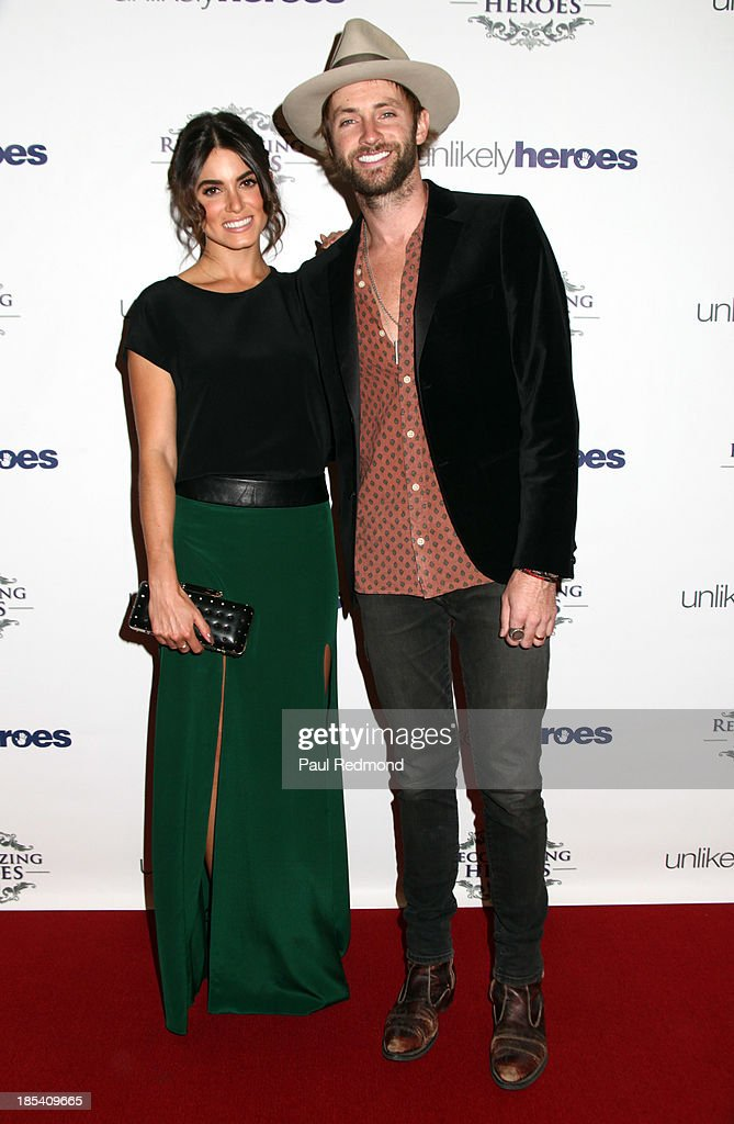 Actress Nikki Reed (L) and husband singer Paul McDonald attends 'Unlikely Heroes' Recognizing Heroes Awards Dinner and Gala at The Living Room at The W Hotel on October 19, 2013 in Los Angeles, California.