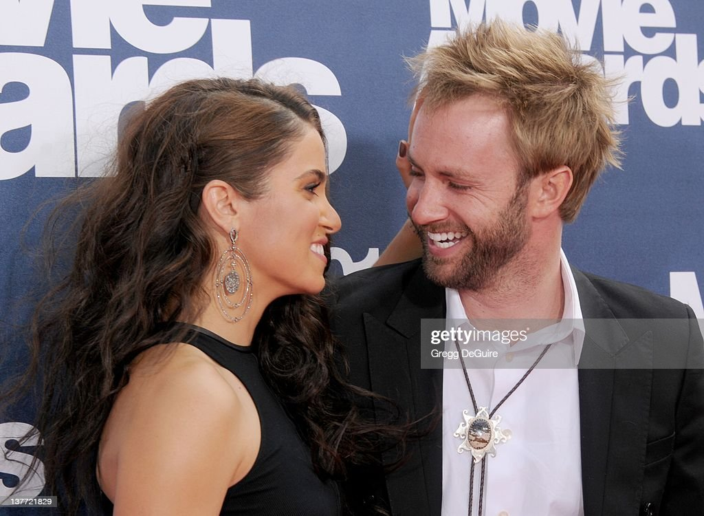 Actress <a gi-track='captionPersonalityLinkClicked' href=/galleries/search?phrase=Nikki+Reed&family=editorial&specificpeople=220844 ng-click='$event.stopPropagation()'>Nikki Reed</a> and Paul McDonald arrive at the 2011 MTV Movie Awards at the Gibson Amphitheatre on June 5, 2011 in Universal City, California.