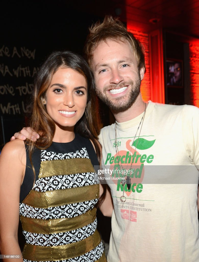Actress <a gi-track='captionPersonalityLinkClicked' href=/galleries/search?phrase=Nikki+Reed&family=editorial&specificpeople=220844 ng-click='$event.stopPropagation()'>Nikki Reed</a> and Paul McDonald attend 'The Twilight Saga: Breaking Dawn Part 2' VIP Comic-Con Celebration Sponsored by Fandango at Float in the Hard Rock Hotel on July 11, 2012 in San Diego, California.