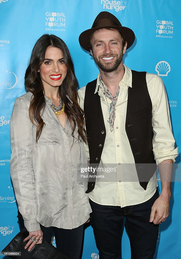 Actress Nikki Reed (L) and Recording Artist Paul McDonald (R) attend the 'mPowering Action' platform launch at The Conga Room at L.A. Live on February 8, 2013 in Los Angeles, California.
