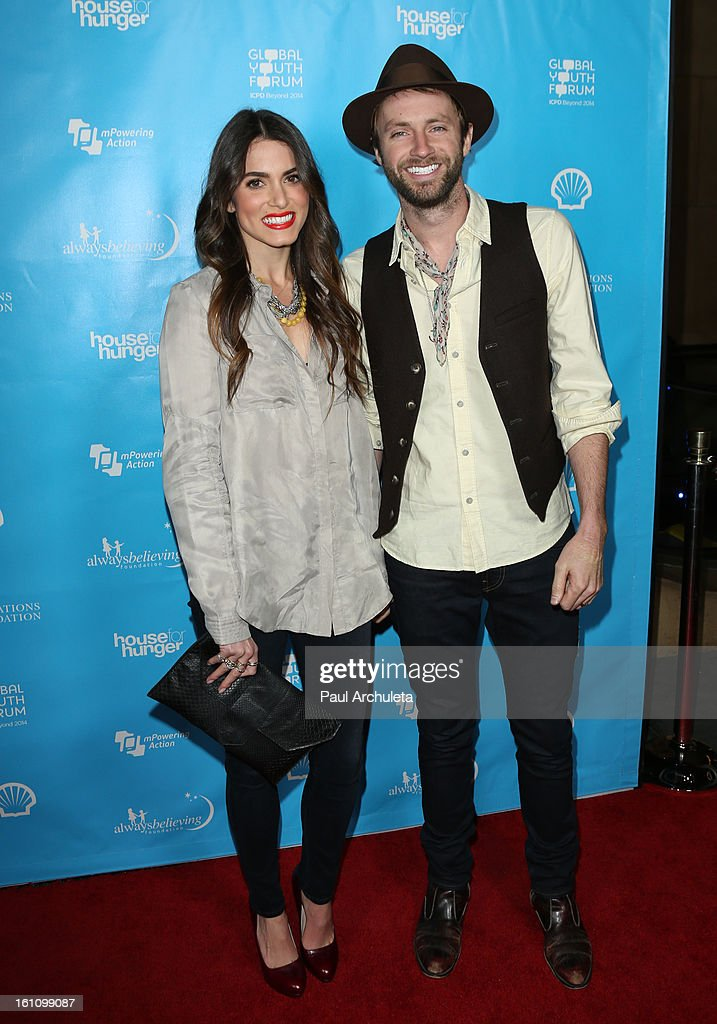 Actress <a gi-track='captionPersonalityLinkClicked' href=/galleries/search?phrase=Nikki+Reed&family=editorial&specificpeople=220844 ng-click='$event.stopPropagation()'>Nikki Reed</a> (L) and Recording Artist Paul McDonald (R) attend the 'mPowering Action' platform launch at The Conga Room at L.A. Live on February 8, 2013 in Los Angeles, California.
