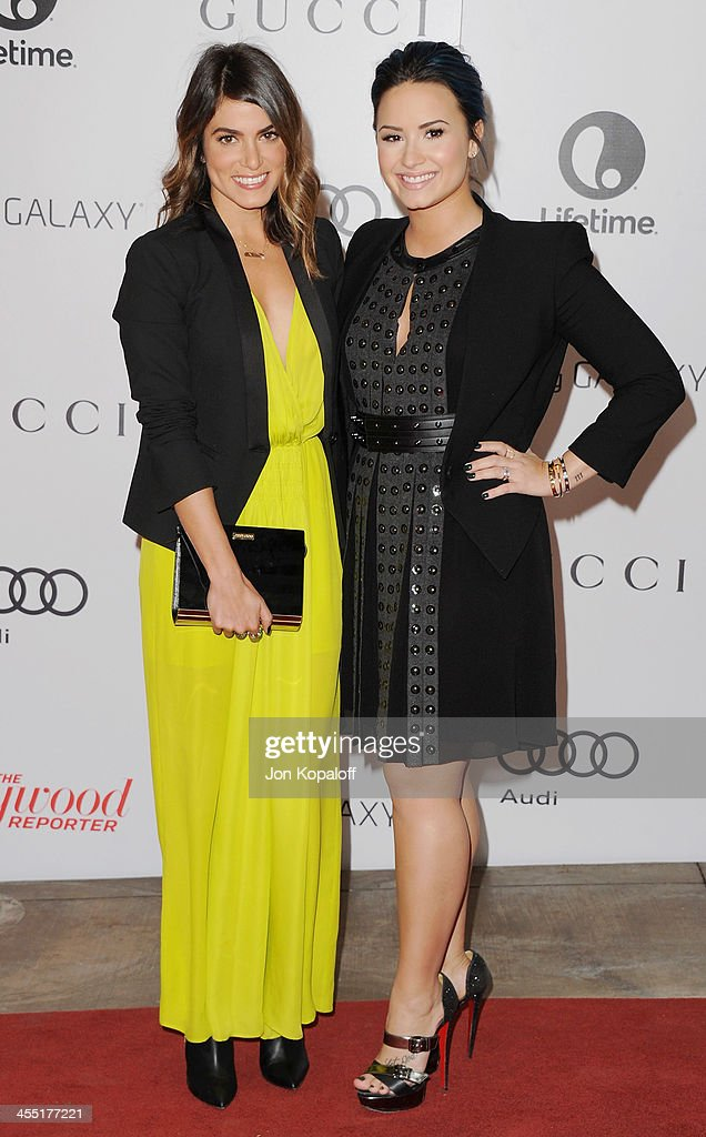 Actress Nikki Reed and singer Demi Lovato arrive at The Hollywood Reporter's 22nd Annual Women In Entertainment Breakfast 2013 at Beverly Hills Hotel on December 11, 2013 in Beverly Hills, California.