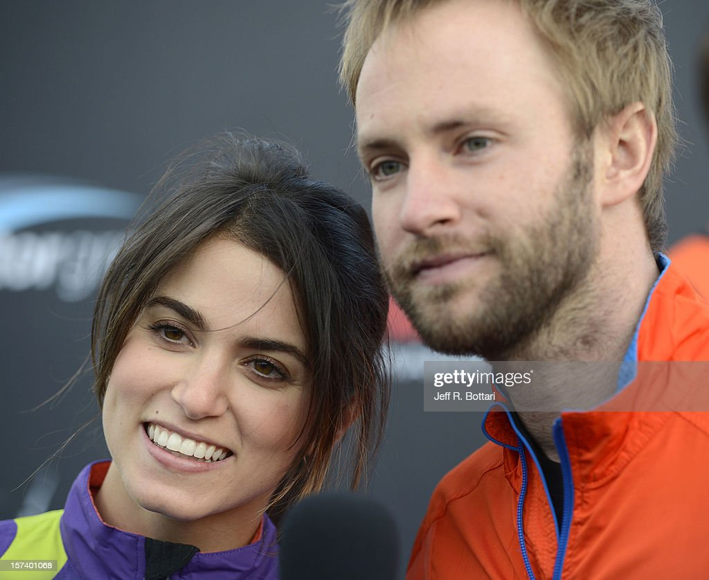 Actress <a gi-track='captionPersonalityLinkClicked' href=/galleries/search?phrase=Nikki+Reed&family=editorial&specificpeople=220844 ng-click='$event.stopPropagation()'>Nikki Reed</a> (L) and singer Paul McDonald arrive at the Zappos.com Rock 'n' Roll Las Vegas Marathon and Half-Marathon on December 2, 2012 in Las Vegas, Nevada.
