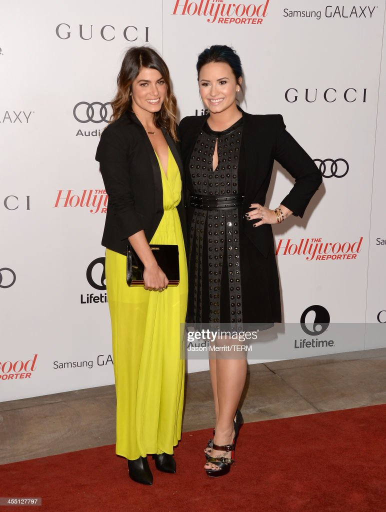 Actress Nikki Reed and singer/songwriter Demi Lovato arrive at The Hollywood Reporter's 22nd Annual Women In Entertainment Breakfast at Beverly Hills Hotel on December 11, 2013 in Beverly Hills, California.