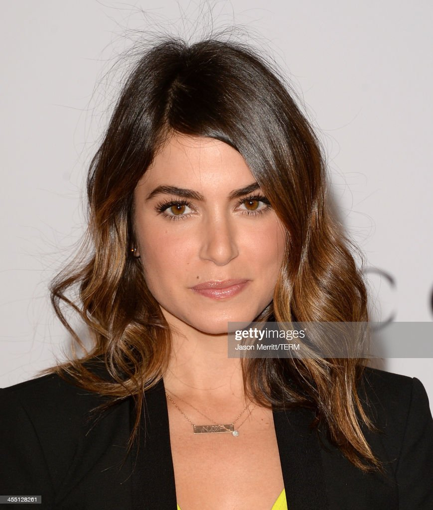 Actress <a gi-track='captionPersonalityLinkClicked' href=/galleries/search?phrase=Nikki+Reed&family=editorial&specificpeople=220844 ng-click='$event.stopPropagation()'>Nikki Reed</a> arrives at The Hollywood Reporter's 22nd Annual Women In Entertainment Breakfast at Beverly Hills Hotel on December 11, 2013 in Beverly Hills, California.
