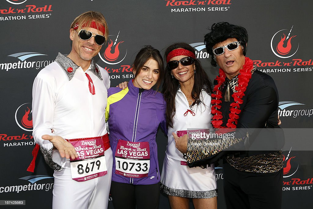 Actress Nikki Reed (2nd L) arrives at the Zappos.com Rock 'n' Roll Las Vegas Marathon joined by Elvis Presley impersonators on December 2, 2012 in Las Vegas, Nevada.