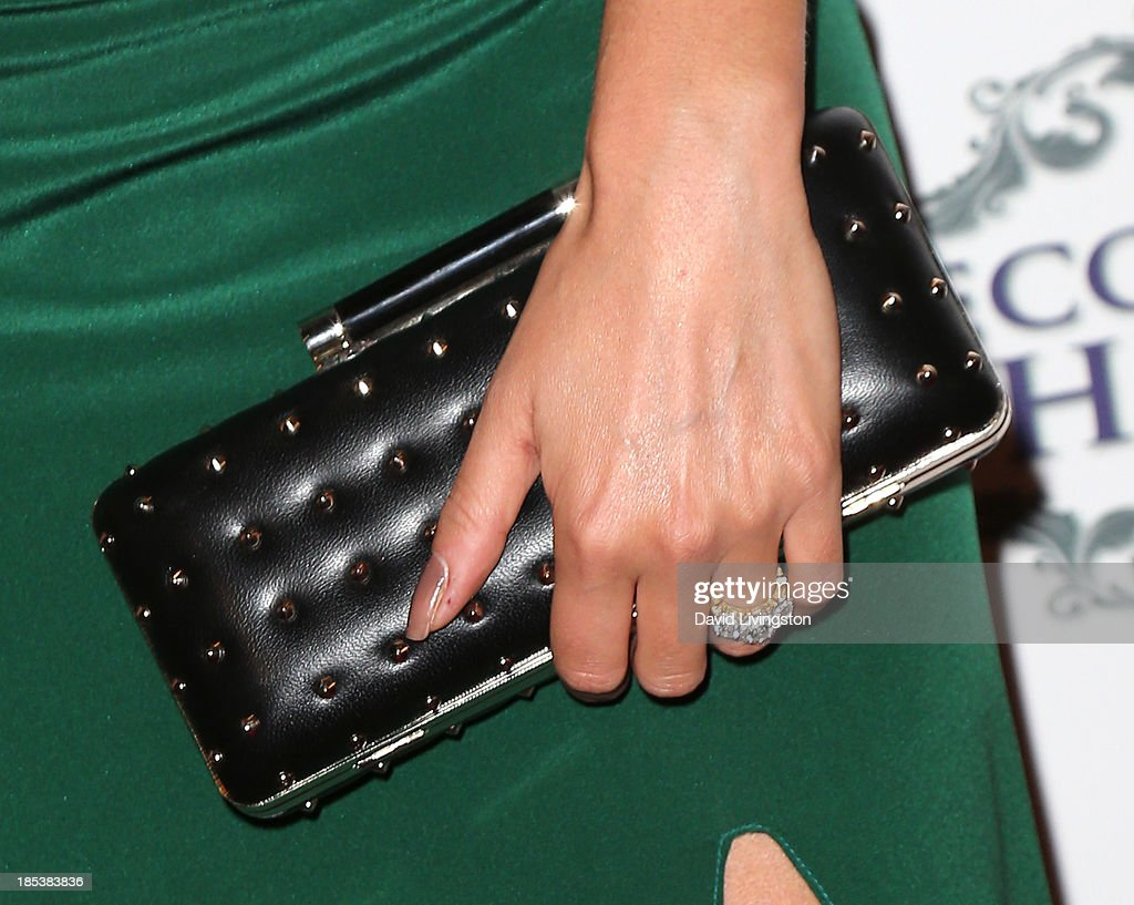 Actress Nikki Reed (purse & ring detail) attends the Unlikely Heroes' Recognizing Heroes Awards Dinner & Gala at The Living Room at The W Hotel on October 19, 2013 in Los Angeles, California.