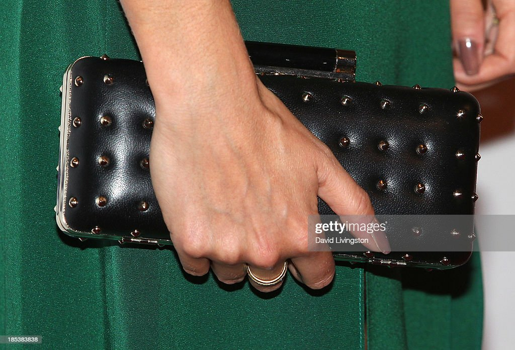 Actress Nikki Reed (purse detail) attends the Unlikely Heroes' Recognizing Heroes Awards Dinner & Gala at The Living Room at The W Hotel on October 19, 2013 in Los Angeles, California.