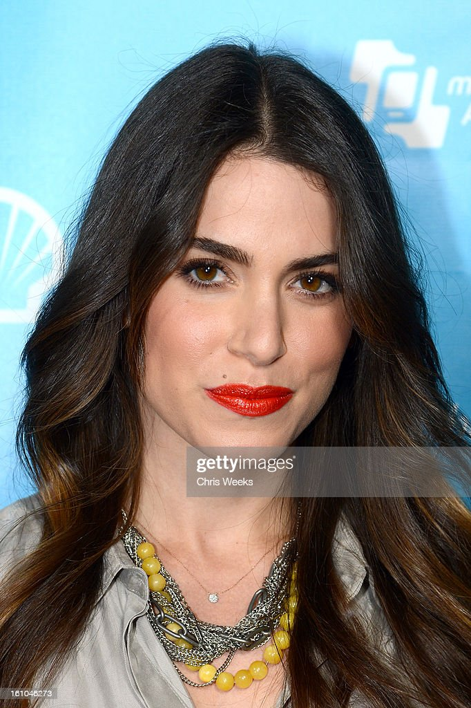 Actress <a gi-track='captionPersonalityLinkClicked' href=/galleries/search?phrase=Nikki+Reed&family=editorial&specificpeople=220844 ng-click='$event.stopPropagation()'>Nikki Reed</a> joins mPowering Action, a global mobile youth movement at Grammy Week launch, featuring performances by Timbaland and Avicii at The Conga Room at L.A. Live on February 8, 2013 in Los Angeles, California.