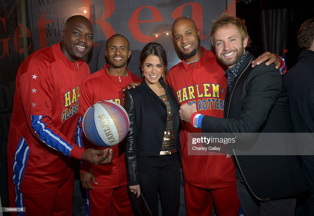 Actress <a gi-track='captionPersonalityLinkClicked' href=/galleries/search?phrase=Nikki+Reed&family=editorial&specificpeople=220844 ng-click='$event.stopPropagation()'>Nikki Reed</a> (C), musician Paul McDonald (R) and the Harlem Globetrotters attend the Rolling Stone Magazine Official 2012 American Music Awards VIP after party presented by Nokia and Rdio at Rolling Stone Restaurant And Lounge on November 18, 2012 in Los Angeles, California.