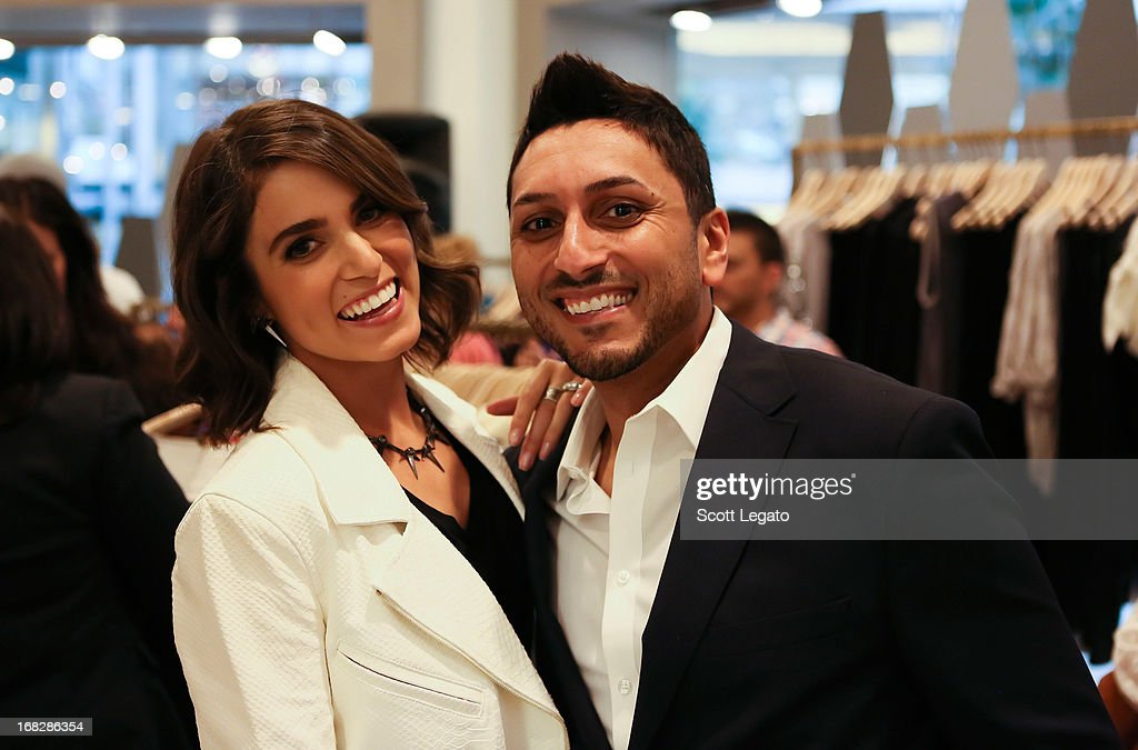 Actress Nikki Reed poses with a fan at 7 For All Mankind x Nikki Reed Jewelry Collection Launch on May 7, 2013 in Troy, Michigan.