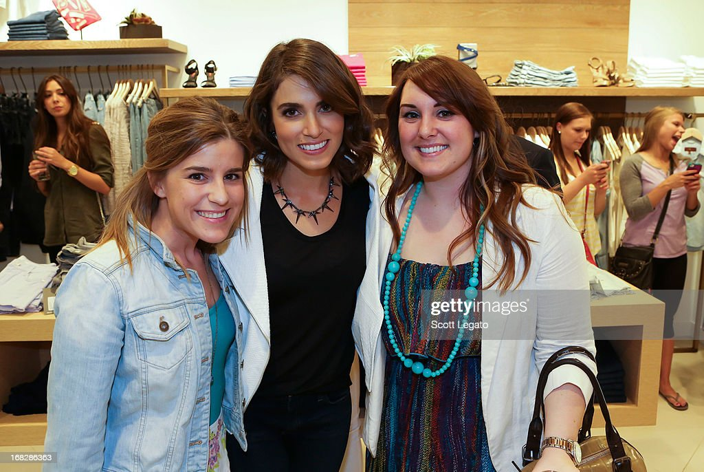 Actress <a gi-track='captionPersonalityLinkClicked' href=/galleries/search?phrase=Nikki+Reed&family=editorial&specificpeople=220844 ng-click='$event.stopPropagation()'>Nikki Reed</a> poses with fans at 7 For All Mankind x <a gi-track='captionPersonalityLinkClicked' href=/galleries/search?phrase=Nikki+Reed&family=editorial&specificpeople=220844 ng-click='$event.stopPropagation()'>Nikki Reed</a> Jewelry Collection Launch on May 7, 2013 in Troy, Michigan.