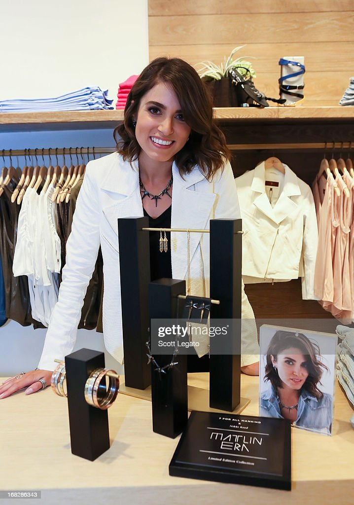 Actress Nikki Reed poses with her 7 For All Mankind x Nikki Reed jewelry collection at 7 For All Mankind x Nikki Reed Jewelry Collection Launch on May 7, 2013 in Troy, Michigan.