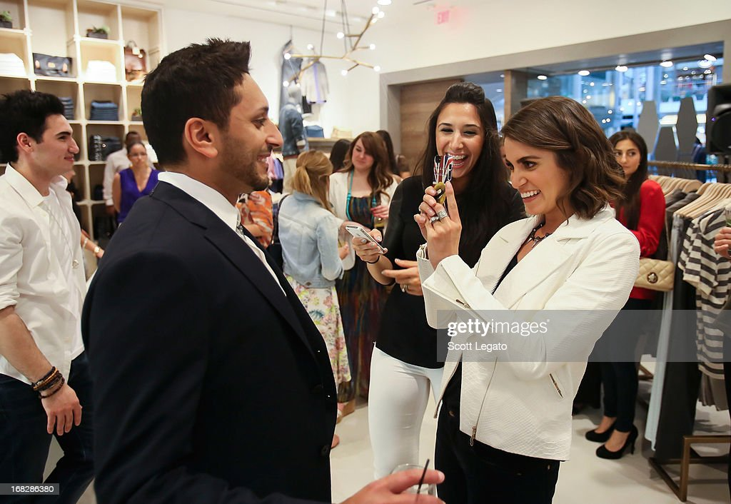 Actress <a gi-track='captionPersonalityLinkClicked' href=/galleries/search?phrase=Nikki+Reed&family=editorial&specificpeople=220844 ng-click='$event.stopPropagation()'>Nikki Reed</a> snaps a pic of a customer wearing her jewelry at 7 For All Mankind x <a gi-track='captionPersonalityLinkClicked' href=/galleries/search?phrase=Nikki+Reed&family=editorial&specificpeople=220844 ng-click='$event.stopPropagation()'>Nikki Reed</a> Jewelry Collection Launch on May 7, 2013 in Troy, Michigan.