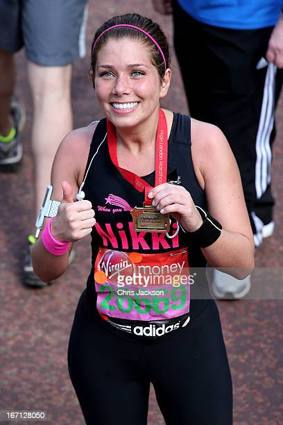 Actress Nikki Sanderson crosses the finish line during the Virgin London Marathon 2013 on April 21 2013 in London England