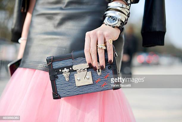 Actress Nikkie Plessen poses before the Louis Vuitton show with a Louis Vuitton clutch on Day 9 of Paris Fashion Week Womenswear FW15 on March 11...