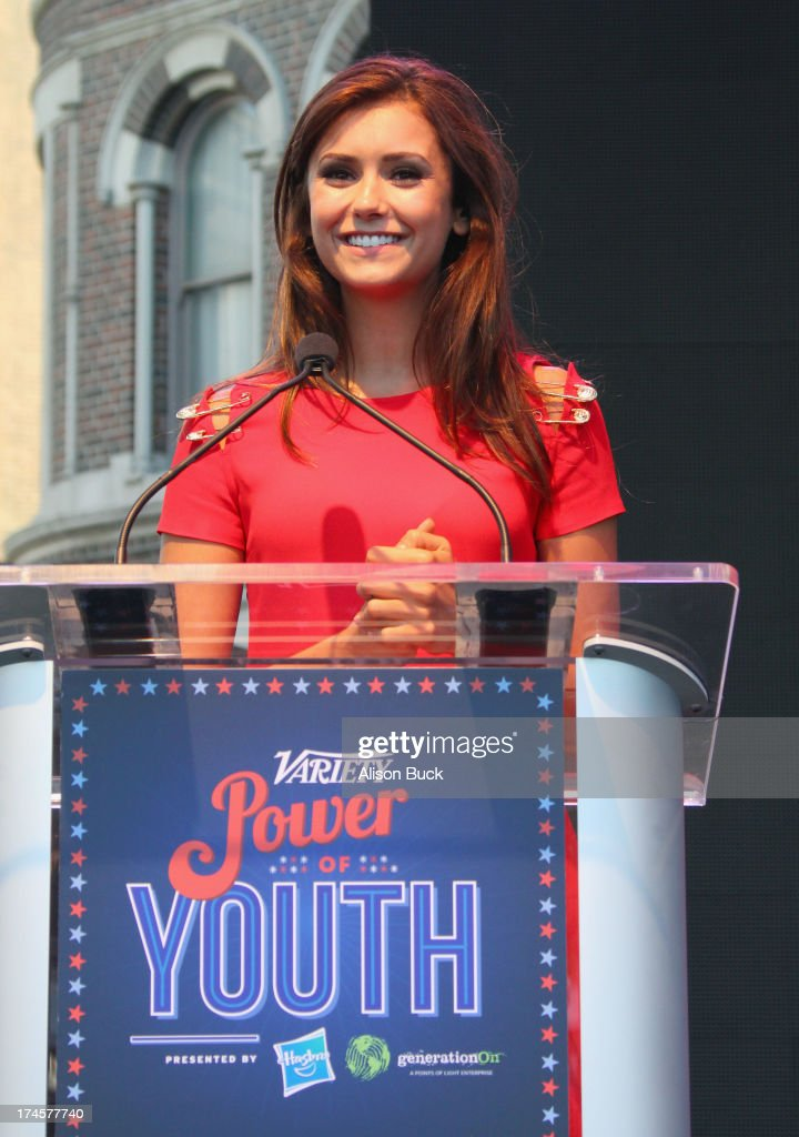 Actress Nina Dobrev accepts award onstage during Variety's Power of Youth presented by Hasbro Inc and generationOn at Universal Studios Backlot on...