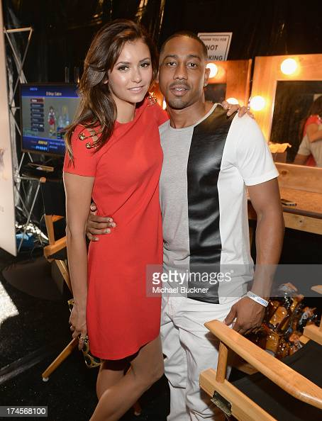Actress Nina Dobrev and host Brandon T Jackson attend Variety's Power of Youth presented by Hasbro Inc and generationOn at Universal Studios Backlot...