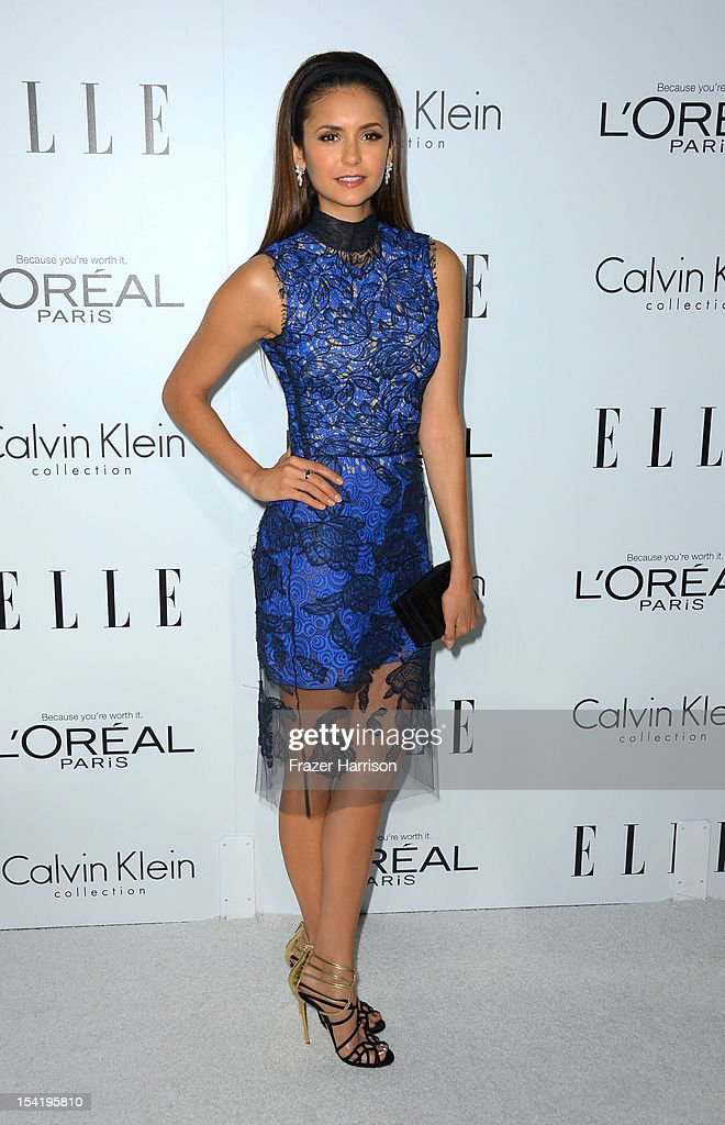 Actress <a gi-track='captionPersonalityLinkClicked' href=/galleries/search?phrase=Nina+Dobrev&family=editorial&specificpeople=4397485 ng-click='$event.stopPropagation()'>Nina Dobrev</a> arrives at ELLE's 19th Annual Women In Hollywood Celebration at the Four Seasons Hotel on October 15, 2012 in Beverly Hills, California.