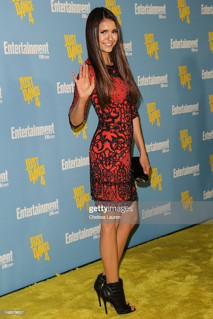 Actress <a gi-track='captionPersonalityLinkClicked' href=/galleries/search?phrase=Nina+Dobrev&family=editorial&specificpeople=4397485 ng-click='$event.stopPropagation()'>Nina Dobrev</a> arrives at Entertainment Weekly's Comic-Con celebration at Float at Hard Rock Hotel San Diego on July 14, 2012 in San Diego, California.