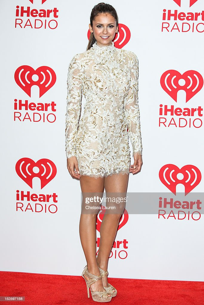 Actress <a gi-track='captionPersonalityLinkClicked' href=/galleries/search?phrase=Nina+Dobrev&family=editorial&specificpeople=4397485 ng-click='$event.stopPropagation()'>Nina Dobrev</a> arrives at iHeartRadio Music Festival press room at MGM Grand Garden Arena on September 22, 2012 in Las Vegas, Nevada.
